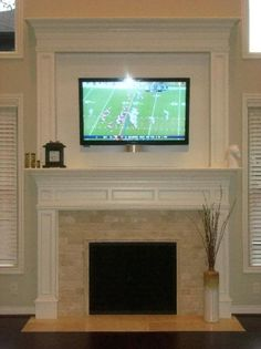 fireplace with fabulous crowned mantle...perfect for the new TV