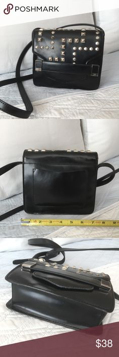 "Authentic Rafe Leather Crossbody Studded Bag Beautiful and authentic Rafe leather crossbody bag! Approximate measurements: NOT EXACT 7 1/2"" x 6 1/2 x 2 1/2"" Strap is adjustable, you can do crossbody. Interior & exterior pockets. USED and in good condition (marks,scratches) NO TRADE ❌ Rafe Bags Crossbody Bags"