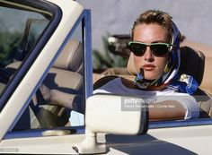 News Photo : Model Tatjana Patitz sitting in a car, wearing a...