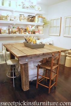 love the rustic craft table and the shelves