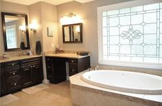 Traditional Full Bathroom with Raised panel, Wall sconce, Simple Granite, limestone tile floors, High ceiling, Flush