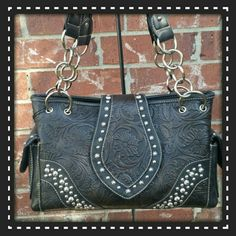 Black embossed leather purse Great shoulder purse. Black leather with floral embossed print. Silver studs. Double straps. Inside and outside side zipper pockets. Main compartment is divided by zipper pocket. Top zipper closure. Signature Montana West inner lining. New with tags and dustbag. Montana West Bags Shoulder Bags