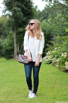 Axelle Blanpain of Style playground is wearing an Asos blazer, Mango top, American Eagle jeggings, white Converse, Celine Audrey sunglasses, S Oliver bag, Tiffany & Co T bracelet & Cartier love bracelet