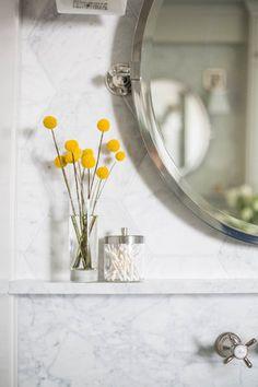 White marble bathroom vanity with ledge   Carla Aston, Designer   Tori Aston, Photographer