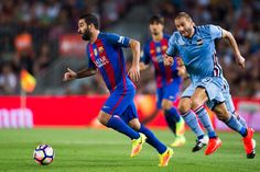 Arda Turan of FC Barcelona runs with the ball next to Lorenzo De Silvestri of UC Sampdoria during the Joan Gamper trophy match between FC Barcelona and UC Sampdoria at Camp Nou on August 10, 2016 in Barcelona, Catalonia.