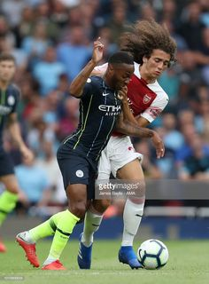 Raheem Sterling of Manchester City and Matteo Guendouzi of Arsenal during the Premier League match between Arsenal FC and Manchester City at Emirates Stadium on August 12, 2018 in London, United Kingdom.