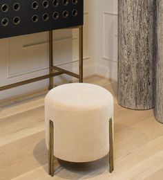 KELLY WEARSTLER | MELANGE FOOT STOOL. Features brass legs in a soulfully textured burnished bronze.