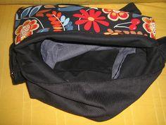 Interior pana negra y loneta,con bolsillos en los 2 lados