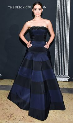 EMMY ROSSUM wears a navy-and-black Carolina Herrera gown to the Frick Collection's Young Fellows ball in N.Y.C