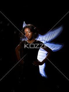 girl dressed as a fairy - Girl dressed as a fairy puts her hand over her waist. MUA: WRIGHT ARTISTRY -  Model: Skalktesh White