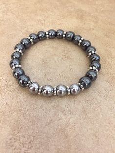 A personal favorite from my Etsy shop https://www.etsy.com/listing/534073174/bkack-silver-stackable-bracelets