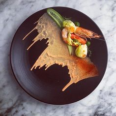"""Perfect Prawn Coctail...Beautiful south Australian prawns, hearth of iceberg lettuce,compressed tomato , lettuce puree,pickled cucumber, Maria Rose…"""