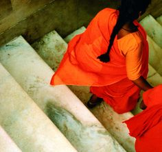 Orange saris and stone steps, India.