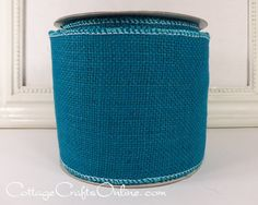 """Turquoise blue burlap, 4"""" wide, with a wired edge, 100% natural jute by d stevens ribbon, producer of high end luxury ribbons from the Cottage Crafts Online shop on Etsy."""
