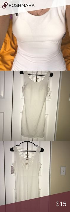 Kevin White Women's Dress Super sexy dress, great for parties and date nights. Brand new with tags.The fabric is stretchy so it could fit a size small as well. Can be worn without a bra as it has built in cups. It's made and bought in Italy. Kevin Dresses Mini