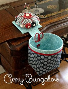 I have been playing around with an old design. I had been making these yo-yo pincushions and thread catchers a few years ago, but sto. Sewing Room Storage, Sewing Rooms, Small Sewing Projects, Sewing Hacks, Fabric Crafts, Sewing Crafts, Thread Catcher, Rope Crafts, Sewing Box