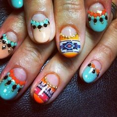 Bold patterned nail art is a statement beauty look.