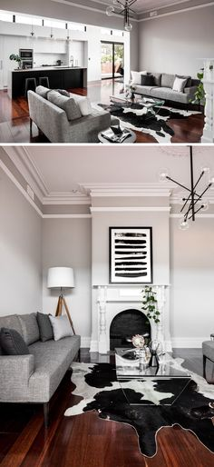 This renovated living room has retained design elements from the original house, like the crown molding and original fireplace.