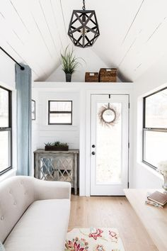 The Lindley, a tiny house from Tiny House Construction. A traditional-style tiny house with cypress siding, a loft bedroom and a full kitchen.