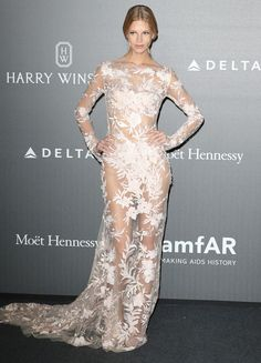 At the amfAR Gala in Milan, tons of models wore different versions of the naked dress trend—see their stunning looks.