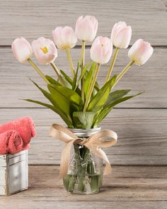 "{$tab:description} Impressive decorating is easy Wouldn't it be wonderful to walk outside and cut a handful of fresh tulips? Capture the spirit of a farmhouse garden with lifelike tulips arranged in a pint mason jar with our crystal clear acrylic water and accented with a burlap ribbon bow. Enjoy these lovely tulips forever! {$tab:DETAILS}  14"" Height x 12"" Width Pint Mason Jar - 5""H x 3""Diameter Capture Springtime Freshness Forever Available in 4 Vibrant Colors Arrives Fully Shaped & Rea..."