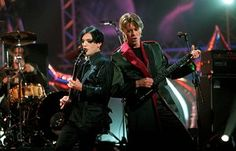 David Bowie performs at the Brit Awards in 1999.