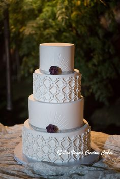 Diamond & Pleats with a delicate floral accent made by Las Vegas Custom Cakes