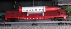 Lionel postwar # 6175 US. Navy Rocket on a red flatcar.