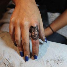 wolf on finger