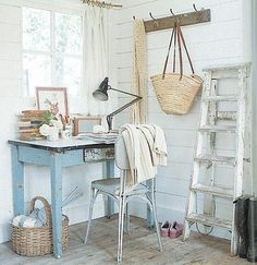 I'm a huge fan of this little book nook, which could work well in a bedroom.  Everything about it - the chippy old desk, the awesome swing-arm lamp and especially the straw bag slung over a hook -- gives me a feeling of homey comfort.  A desk under a window is a great place to get work done, too.