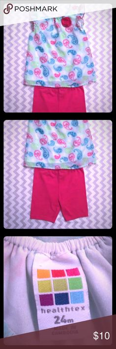 """Healthtex Summer Outfit- Neon Paisleys Healthtex brand toddler girl outfit. Size 24m. Lime green and hot pink paisley design shirt with hot pink shorts. In great condition, no stains or rips. Perfect for this upcoming warmer weather! The material is cool and breathable.   Measurements-  Top- Chest: 10.5 in. Length: 12.5 in. Shoulders: 7.75 in. Sleeves: 1"""" cap sleeve  Shorts- Waist: 8 in. Length: a little over 9 in. Inseam: almost 4 in. Healthtex Matching Sets"""