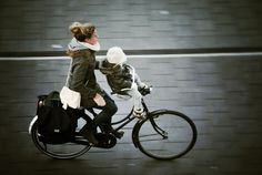 Stylish Mom and baby wrapped in wool for a winter ride.