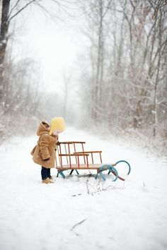 love to go out in the snow...this little sled is the same type that my Dad used to take me and my sister out to sled in...oh what nice memories!