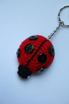 Hand crocheted ladybug keyring made from acrylic yarn, stuffed with polyester. Measures approx. 5.5 cm x 4.5 cm plus keyring chain. Hand wash recommended.