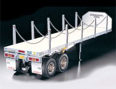 The Tamiya Flatbed Trailer in 1/14 scale is a radio controlled truck trailer suitable for use with any Tamiya radio controlled truck. This highly realistic 1/14 scale flatbead semi-trailer model is for use in combination with Tamiya's 1/14 R/C tractor truck.    A scale appearance is achieved by using authentic components such as aluminum chassis/frame, wood-floored platform and actual chains.