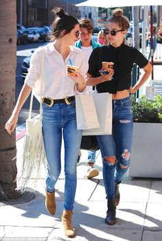 Swapping stories: The #girl friends giggled and laughed as they enjoyed frozen yoghurt while walking along