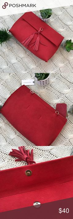 Dreia Envelope Anthropology Red Suede Crossbody Stunning NWT Dreia Envelope Anthropology Red Suede Clutch and comes with strap for Crossbody look!  Dress it up with a gorgeous black dress (see my closet for options) or dress it down with distressed jeans and flats.  Red with tassels on front Gold accents Anthropologie Bags Clutches & Wristlets
