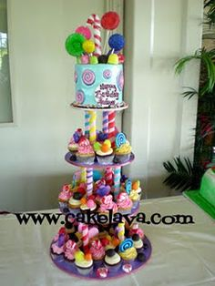 A cute Candy Land cake & cupcake tower.