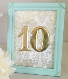 Cute table numbers--could make with scrapbook paper and frames painted in your wedding colors