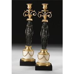 A pair of Russian ormolu and patinated bronze candlesticks l