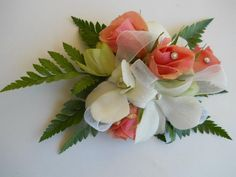 White orchid and peach spray rose wrist corsage