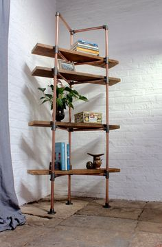 Kirkby Freestanding Shelving made with Reclaimed Scaffolding Boards, Copper Pipe and Adjustable Dark Steel Fittings - Its salvaged vintage industrial design works perfectly in a sophisticated, casual living space. This shelving system can be made to measure to your own specifications. The one shown here is 2050mm high x 370mm deep x 1050mm wide... The pipe is 1.2mm thick walled copper and is 28mm in diameter... this is not regular plumbers pipe - it is 50% thicker and stronger... We used ...