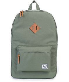 Crafted with a function design and fine regard for detail, the Heritage backpack in the lichen green colorway by Herschel Supply has your carrying needs covered. This mid-size backpack features a roomy main compartment with zipper closures and a padded la