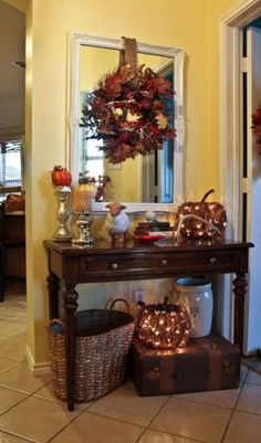 Entry way decorations for fall . I like the idea of lighted pumpkin under the table. I wish people would actually come in our front door!!! by Jinx62