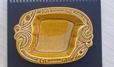 Wharetana Ware / Koruru Dish for sale on Trade Me, New Zealand's auction and classifieds website Tiki Hut, Kiwiana, Objects, Sticker, Carving, Pottery, Crown, Dishes, How To Make
