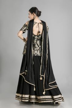 Midnight Muse-The Black and Gold Lehenga with Kameez - Midnight Muse-The Black and Gold Lehenga with Kameez Elegance is a state of being- especially for those who choose to wear what makes them feel most c. Party Wear Indian Dresses, Indian Gowns, Pakistani Dresses, Indian Outfits, Indian Wear, Pakistani Fashion Casual, Indian Fashion, Black And Gold Lehenga, Short Kurti Designs