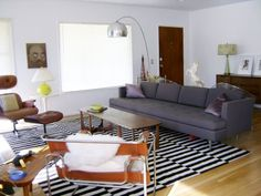 love this room's mid-century modern decor and that IKEA rug