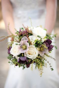 hellebores, roses, pieris foliage, freesia... hellebores are a great choice- Dennis and Diane grow them and they will be in season for your wedding :)