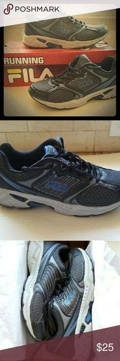 Men's Fila Running Shoes Men's running shoes by FILA, in excellent used condition. Only worn for a week. Size 10. Fila Shoes Athletic Shoes