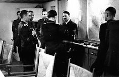 A very disgruntled Hitler on May 16, 1940 at Felsennest. Goering visits (with his back turned).